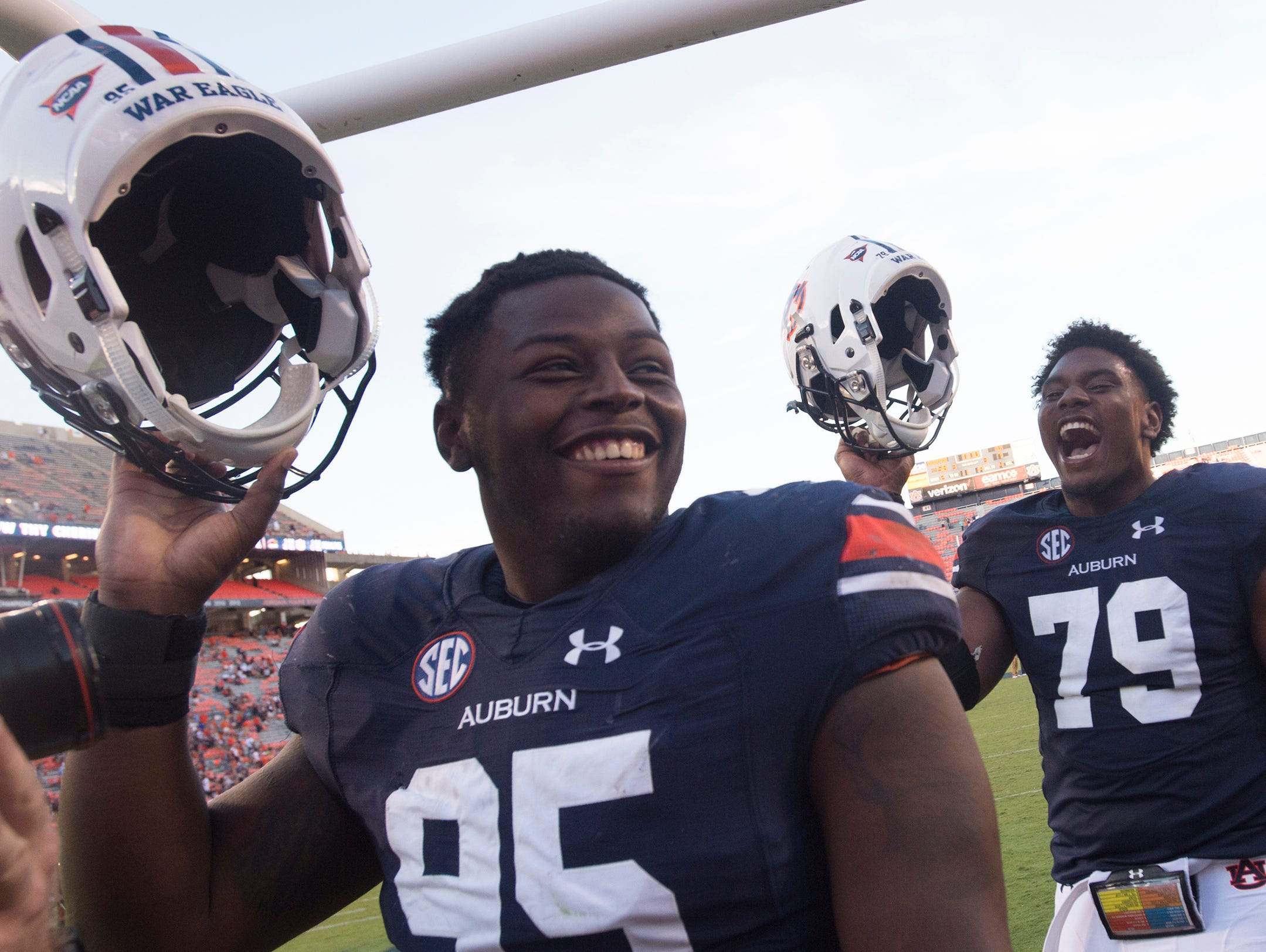 Auburn Tigers defensive lineman Dontavius Russell (95) and Auburn Tigers long snapper Ike Powell (69) walk off the field after Auburn defeated ULM 58-7 in a NCAA football game on Saturday, Oct. 1, 2016, in Auburn, Ala.