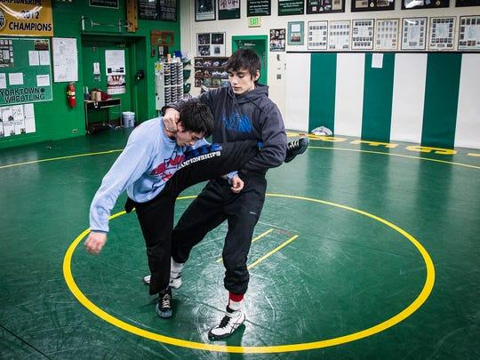 Yorktown wrestlers Brayden and Xayvier Curtis wrestle