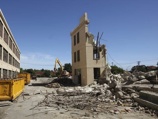 Workers continiue the demolition of one of the buildings in the Piano Works complex in East Rochester on Aug 26, 2008.
