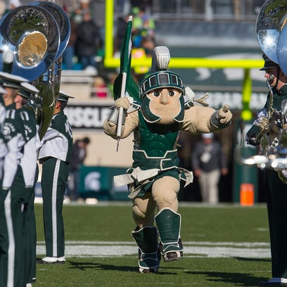 Michigan State Spartans mascot Sparty gets fans revved