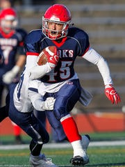 Chenango Forks' Jeremiah Allen eludes Homer's Lars Ross in the first quarter of a Class B state quarterfinal  at Union-Endicott's Ty Cobb Stadium. Allen rushed for 225 yards and two touchdowns in the Blue Devils' 28-9 victory.