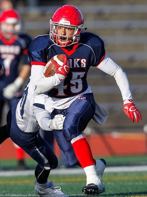 Chenango Forks' Jeremiah Allen eludes Homer's Lars Ross in the first quarter of Saturday's Class B state semifinal at Union-Endicott's Ty Cobb Stadium. Allen rushed for 225 yards and two touchdowns in the Blue Devils' 28-9 victory.