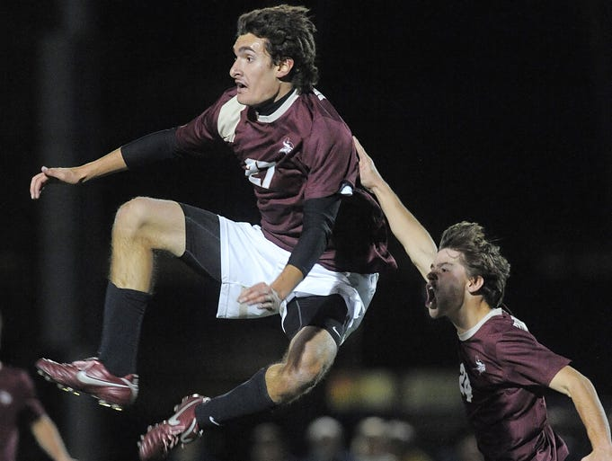 Mendon's Matt Renzi, left, celebrates his first-half goal with Andrew Ricci.