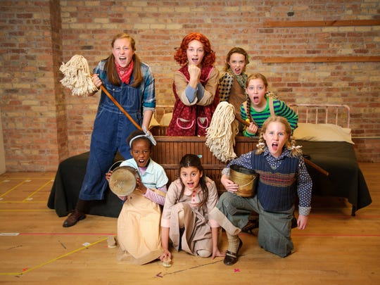 """It's a """"Hard Knock Life"""" for these young cast members of Skylight's """"Annie,"""" clockwise from left: Avery Holmes (with mop), KyLee Hennes (as the red-haired Annie), Lorelei Wesselowski, Phinlee Clarkin, Paisley Schroeder, Taylor Arnstein and Taressa Hennes."""