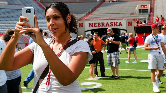"""Nicole Warbelton plays during a """"Pokemon Go"""" event at Memorial Stadium in Lincoln, Neb., Thursday, July 14, 2016. Nebraska Athletic Department officials opened Memorial Stadium for two hours Thursday to accommodate """"Pokemon Go"""" players eager to capture animated monsters at the venerated field."""