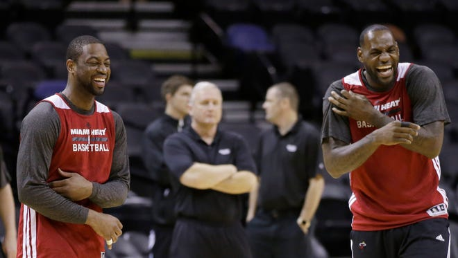 Miami's Dwyane Wade, left, and LeBron James, right, share a laugh at practice on Wednesday in San Antonio. They play Game 1 of the NBA Finals against the San Antonio Spurs on Thursday.