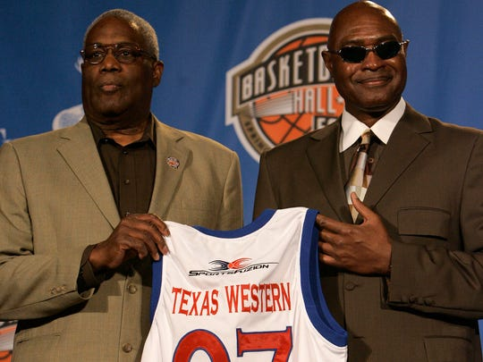 Harry Flournoy, left, and David Lattin, members of the 1966 NCAA National Championship Texas Western basketball team hold their jerseys after being named members of the Naismith Memorial Hall of Fame Class of 2007 in Atlanta, Ga., Monday, April 2, 2007. (AP Photo/Gerry Broome)