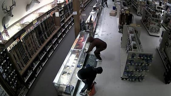 Surveillance video captured 10 suspects who stole guns and ammunition from a Houston gun store on Tuesday, March 1, 2016.