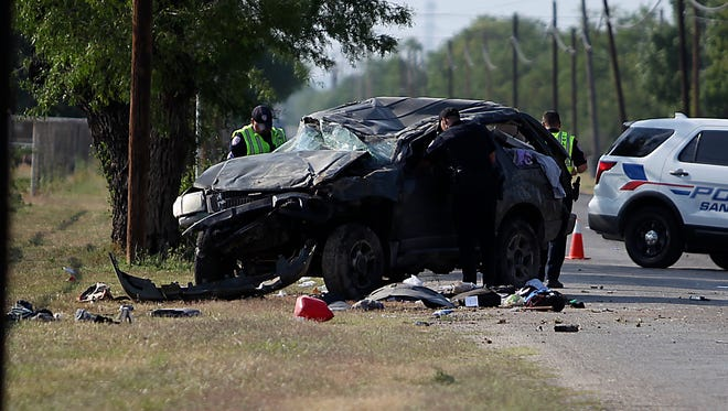 San Angelo police work the crash scene of a one-vehicle roll over crash involving a Ford SUV in the 5100 block of Grape Creek Road Wednesday, May 10, 2017.