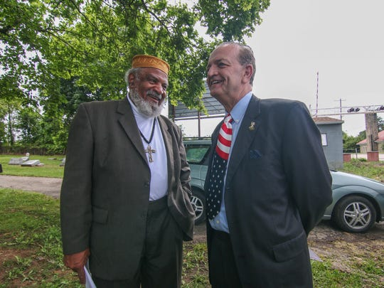 Friends of Mt. Zion's Harmon Carey (left) and New Castle County Executive Tom Gordon speak before Mt. Zion Cemetery's annual Memorial Day celebration earlier this year.