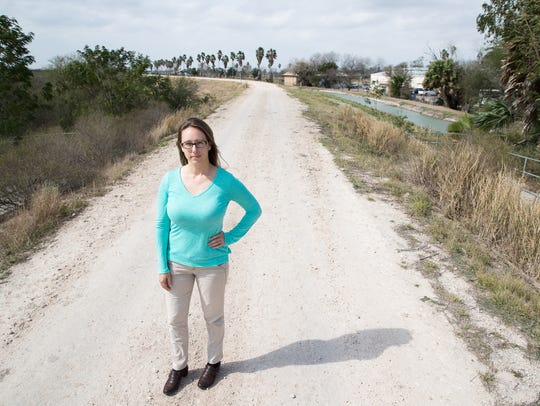Environmentalist Tiffany Kersten stands on a levee inside the Santa Ana National Wildlife Refuge in Alamo, Texas, where the proposed border wall may cut off the wildlife refuge.