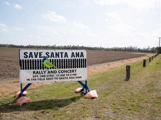 A sign announces a Save Santa Ana rally and concert across the street from the Santa Ana National Wildlife Refuge in Alamo, Texas.
