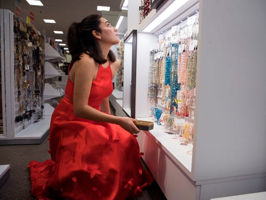 Rockport-Fulton High School student Julieanne Pugh, 18, shops for jewelry at J.C. Penney, on Friday, March 16, 2018. She was selected to receive a head-to-toe makeover for her upcoming prom from J.C. Penney. The prom will be at La Palmera mall.