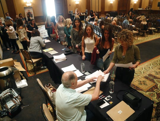 "Women line up to fill out their audition sheets during a casting call for ABC's ""The Bachelor"" at McCormick Ranch in Scottsdale on June 16, 2018."