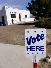 Voters exit the Silver City Woman's Club on Tuesday,
