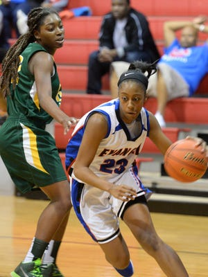 Evangel's Tiara Young drives to the basket during her game against Rayville.