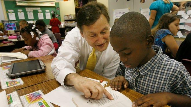 Atkinson principal, Dewey Hensley, left, helped fifth grader Larell Henderson.(Michael Hayman, The Courier-Journal)Sept. 24, 2009