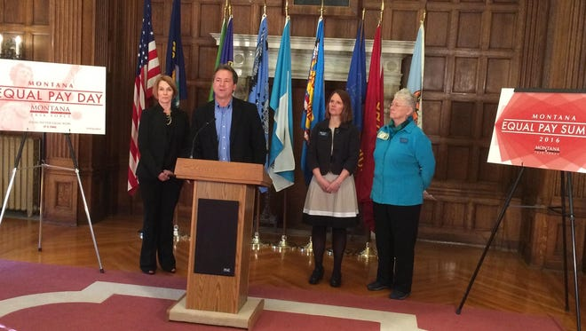 Gov. Steve Bullock talks about his equal pay task force Tuesday as, from left, Department of Administration Director Sheila Hogan, Department of Labor and Industry Commissioner Pam Bucy and Sen. Diane Sands look on.