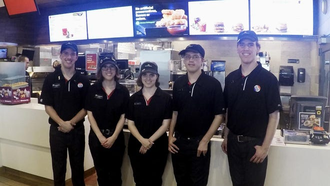 In this Oct. 6, 2016 photo, Lucas, Lauren, Lindsey, Leith and Logan Curtis, left to right, pose in the lobby of a McDonald's in Potterville, Mich. The 18-year-old non-identical quintuplets all work at the Lansing-area restaurant. (AP Photo/Mike Householder)