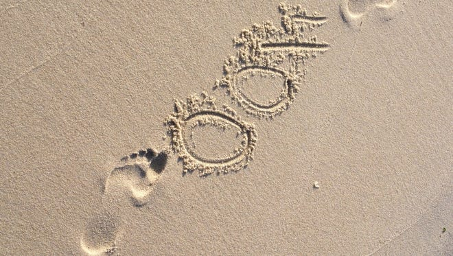 """Vanessa Junkin drew this """"400"""" in between her footprints to commemorate reaching the 400-mile mark in running for the year."""