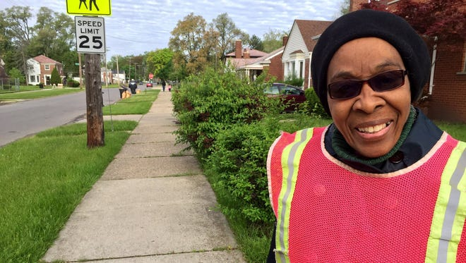 Gwendolyn Britton, 77, stands guard at Schaefer and Pembroke on Detroit's northwest side.
