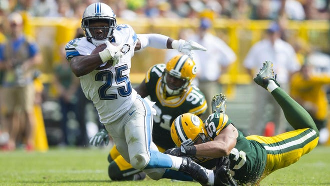 Lions running back Theo Riddick, being tackled by Green Bay linebacker Nick Perry, managed just 9 yards rushing on 10 carries.