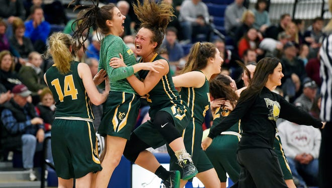 York Catholic's Catherine Tillotson celebrates with teammates Friday, Feb. 23, 2018, after winning a PIAA District 3 Class 3A girls' semifinal basketball game at West York. York Catholic defeated Delone Catholic 57-48 to advance to the district final.
