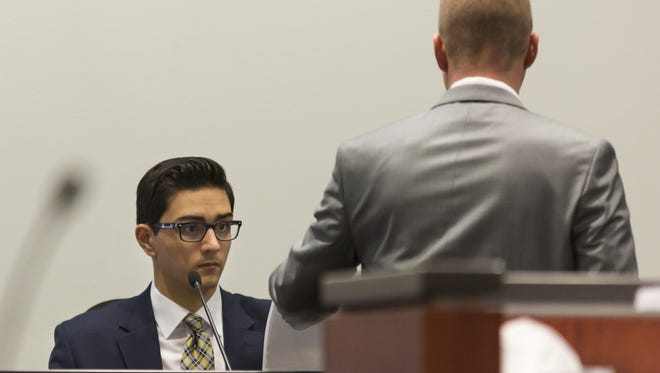 Steven Jones (left) looks at evidence presented by Deputy County Attorney Ammon Barker during his first trial in spring 2017. The case ended in mistrial. The retrial has been rescheduled forMarch 5, 2019, court records show.