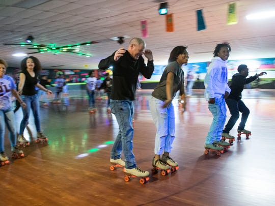"Knoxville Police Chief David Rausch tries to avoid collding with another roller skater at ""Skate for Zae Day"" on Sunday, March 20, 2016. (SAUL YOUNG/NEWS SENTINEL)"