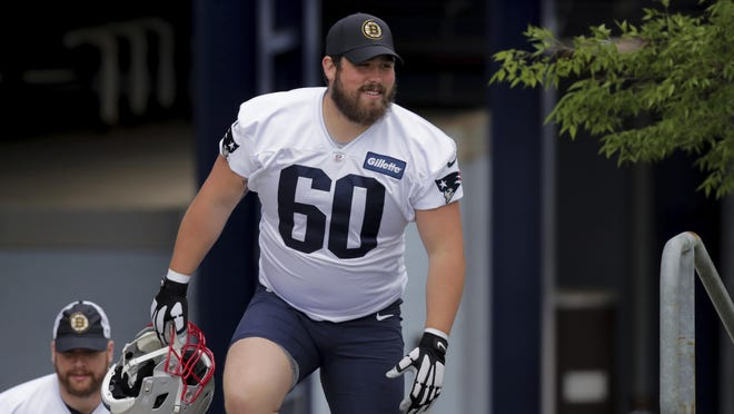 Patriots center David Andrews, a former University of Georgia standout, heads to the practice field during training camp in Foxboro.