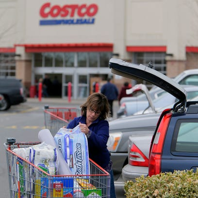 Judy Santilli, Jackson, packs her car after shopping