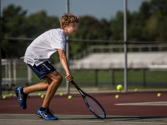 Port Huron Northern's Chase Moeller returns the ball during tennis practice Tuesday, August 30, 2016 at Port Huron Northern High School.