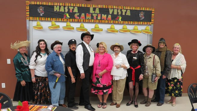 "The cast of ""Burritos and Banditos"": Marianne Johnstone (from left), Caroline Pope, Ruth Cox, Connie Barrett, Clark Hardy, Lorna Hardy, Valerie Thompson, Brigitta Dahlander, Gail Ashdown, Kathie Chatlin and Barb King."