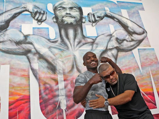 Trainer Joel Diaz, right, makes light of the situation as Timothy Bradley Jr. poses for a photograph in front of a mural at his gym in Indio. He will fight Juan Manuel Marquez in Las Vegas, Oct. 12th. Jay Calderon/The Desert Sun