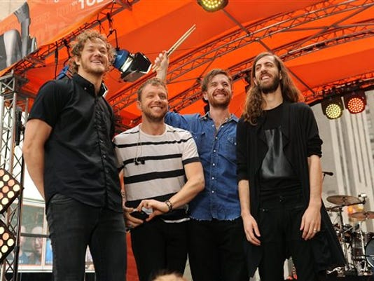 """FILE - In this June 26, 2015 file photo, from left, Dan Reynolds,  Ben McKee, Daniel Platzman and Wayne Sermon of Imagine Dragons appear on NBC's """"Today"""" show in New York."""