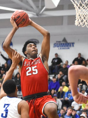 Ball State's Tahjai Teague gets fouled by IPFW's Jordon King as he goes up for two in the first half of Wednesday's CIT Tournament at IPFW. Ball State fell 88-80.