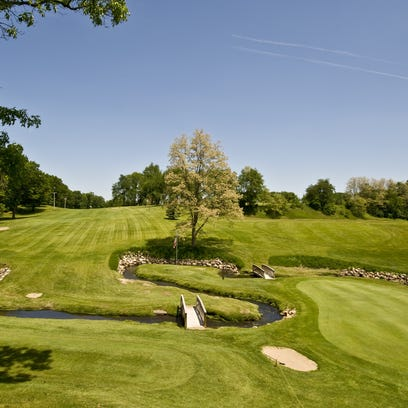 A view of Springbrook's 1st tee and 9th green as seen
