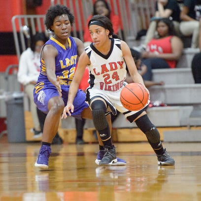 Northside's Harmony Chavis drives to the basket during