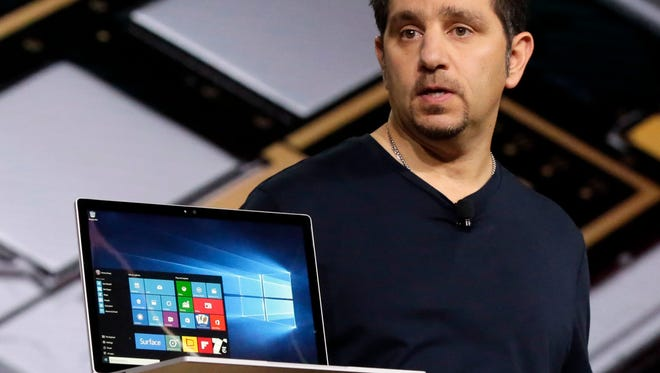 Panos Panay, Microsoft's vice president for Surface computing, holds a Surface Book laptop during a presentation Tuesday in New York. Microsoft says it's for scientists, engineers and gamers who need a lot more performance than a tablet provides.