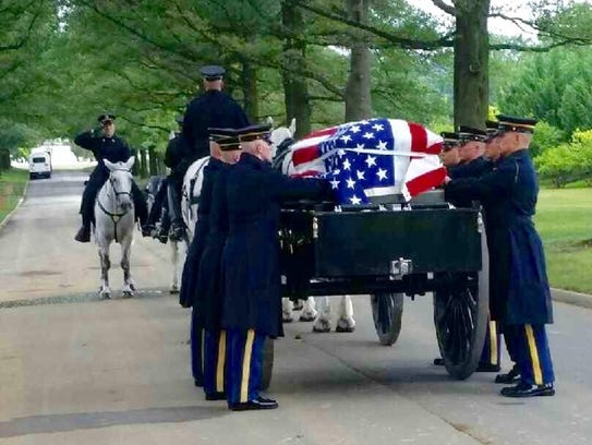 Nehemiah Edward Butler's casket is pulled on a horse-drawn