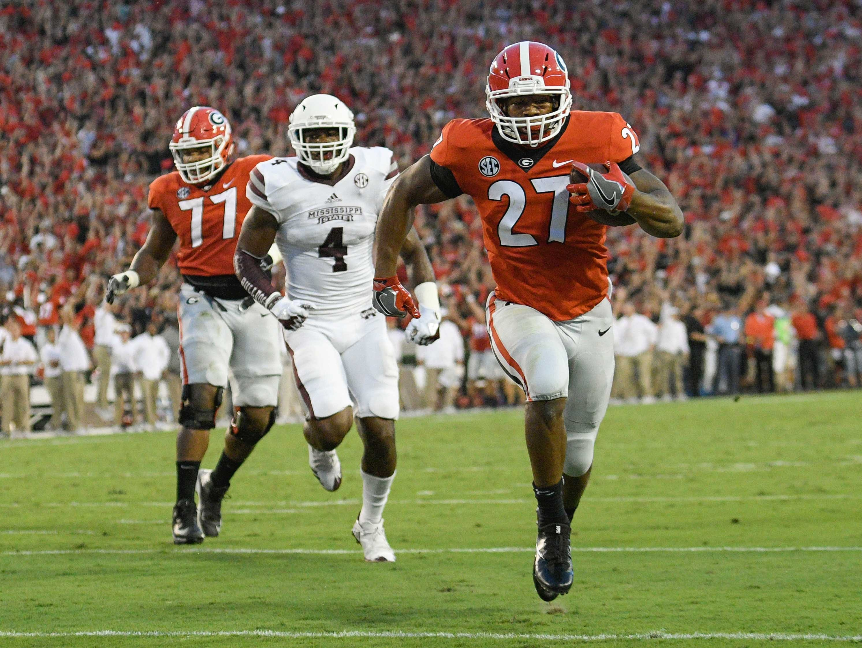 Sep 23, 2017; Athens, GA, USA; Georgia Bulldogs running back Nick Chubb (27) runs for a touchdown against the Mississippi State Bulldogs during the first quarter at Sanford Stadium. Mandatory Credit: Dale Zanine-USA TODAY Sports