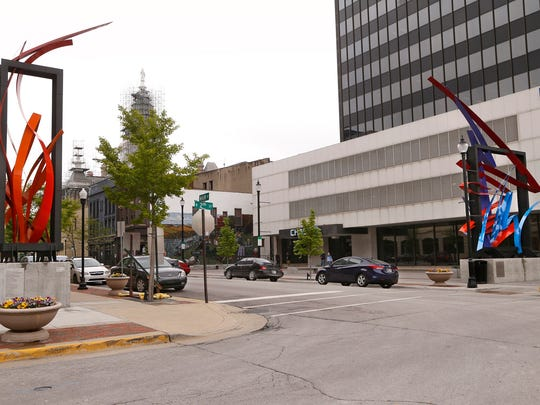 """The sculptures """"Flame,"""" left, and """"What Lines?"""" by artist Jeff Laramore Tuesday, May 9, 2017, at 2nd and Main streets in downtown Lafayette."""
