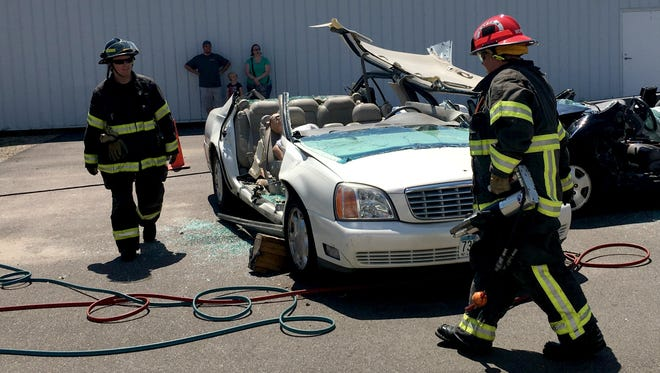 Members of the St. Cloud Fire Department cut apart two cars to demonstrate how they would extract a car accident victim in an emergency during Traffic Safety Day at the Minnesota Highway Safety and Research Center in St. Cloud on Saturday, July 22, 2017.