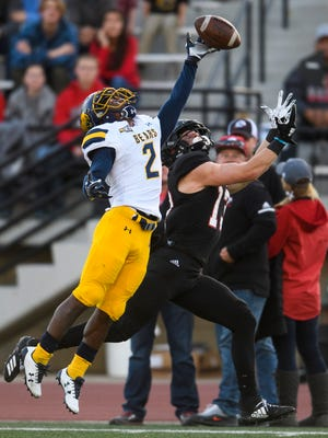 University of Northern Colorado defensive back Isaiah Swopes (2) breaks up a pass intended for Southern Utah University wide receiver Ty Rutledge (13) at SUU Saturday, October 27, 2018.