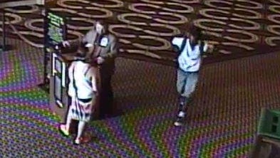 The moment before Jawari Porter, right, lunges for a woman, left, at Horseshoe Casino in 2015.