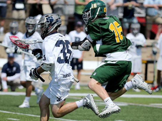 Pittsford #35 Ryan Walpole has the ball knocked out