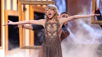 Taylor Swift opened the 2014 American Music Awards at the Nokia Theatre in Los Angeles at Nov. 23, 2014, performing 'Blank Space.'