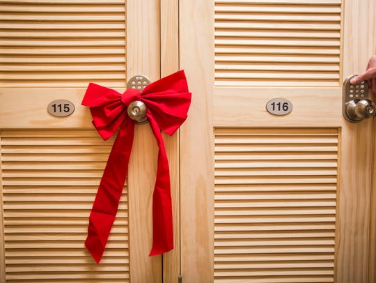 A bow hangs on the door of a wine locker that was recently
