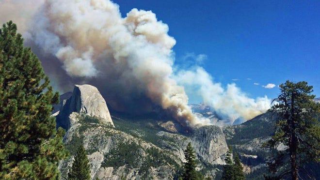 Smoke from a fire rises above Little Yosemite Valley near Yosemite National Park, Calif., Sunday on Sept. 7, 2014.