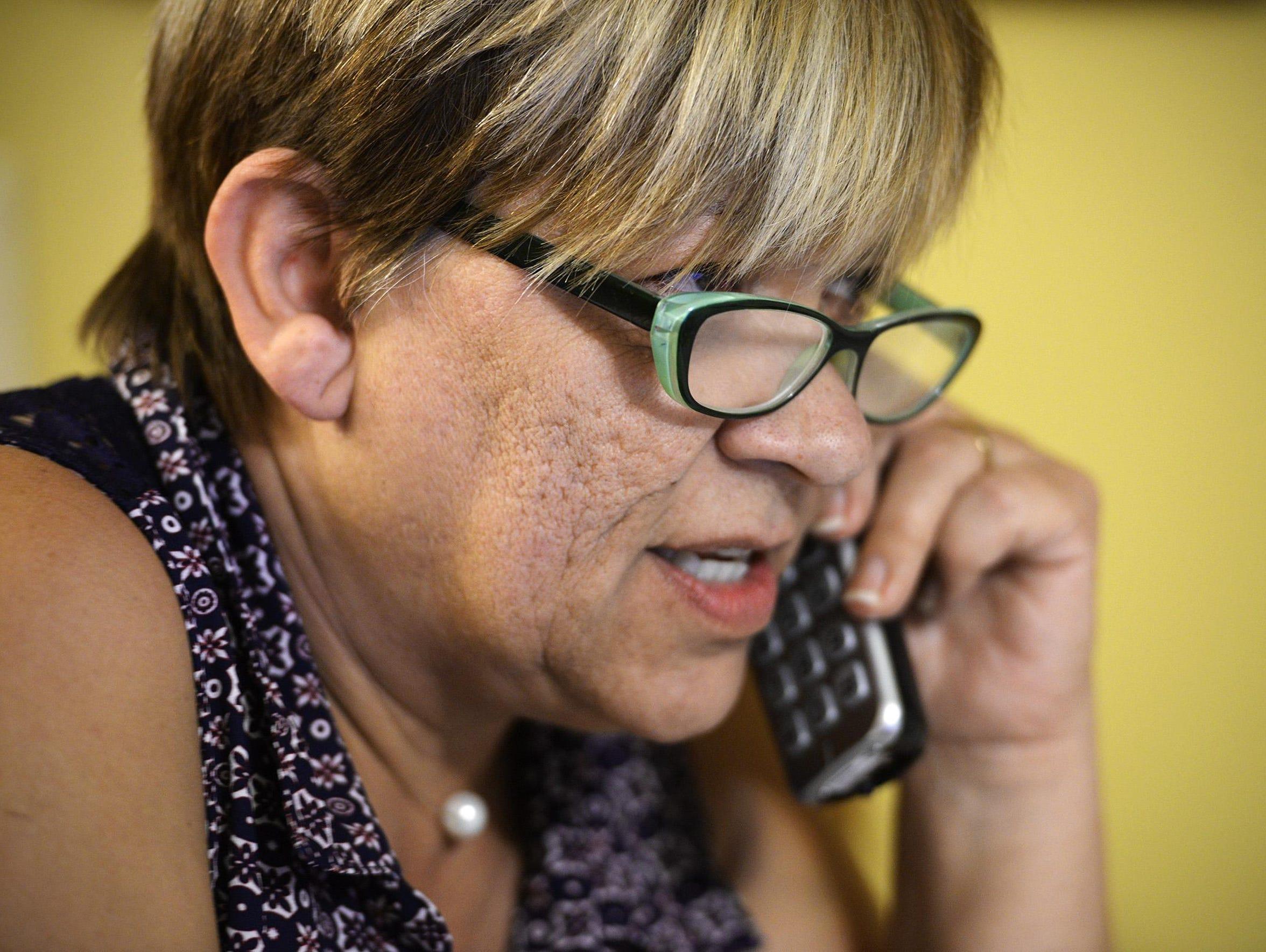 Aspa Rigopoulou-Melcher makes a call to a registry